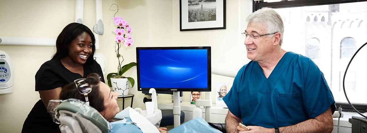 Dentist Explaining Services at Madison Dental Arts